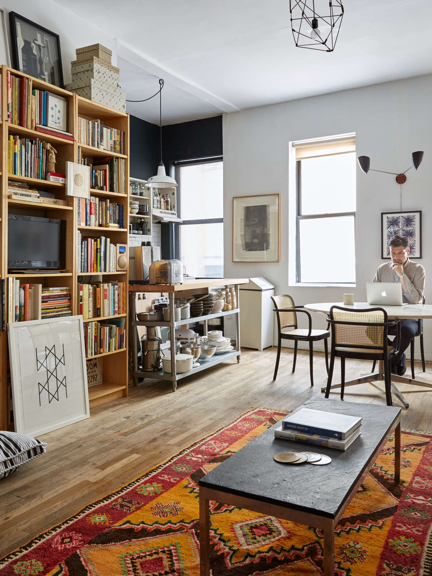 Roman Luba at home in his DIY remodeled NYC apartment | Kate Sears photo