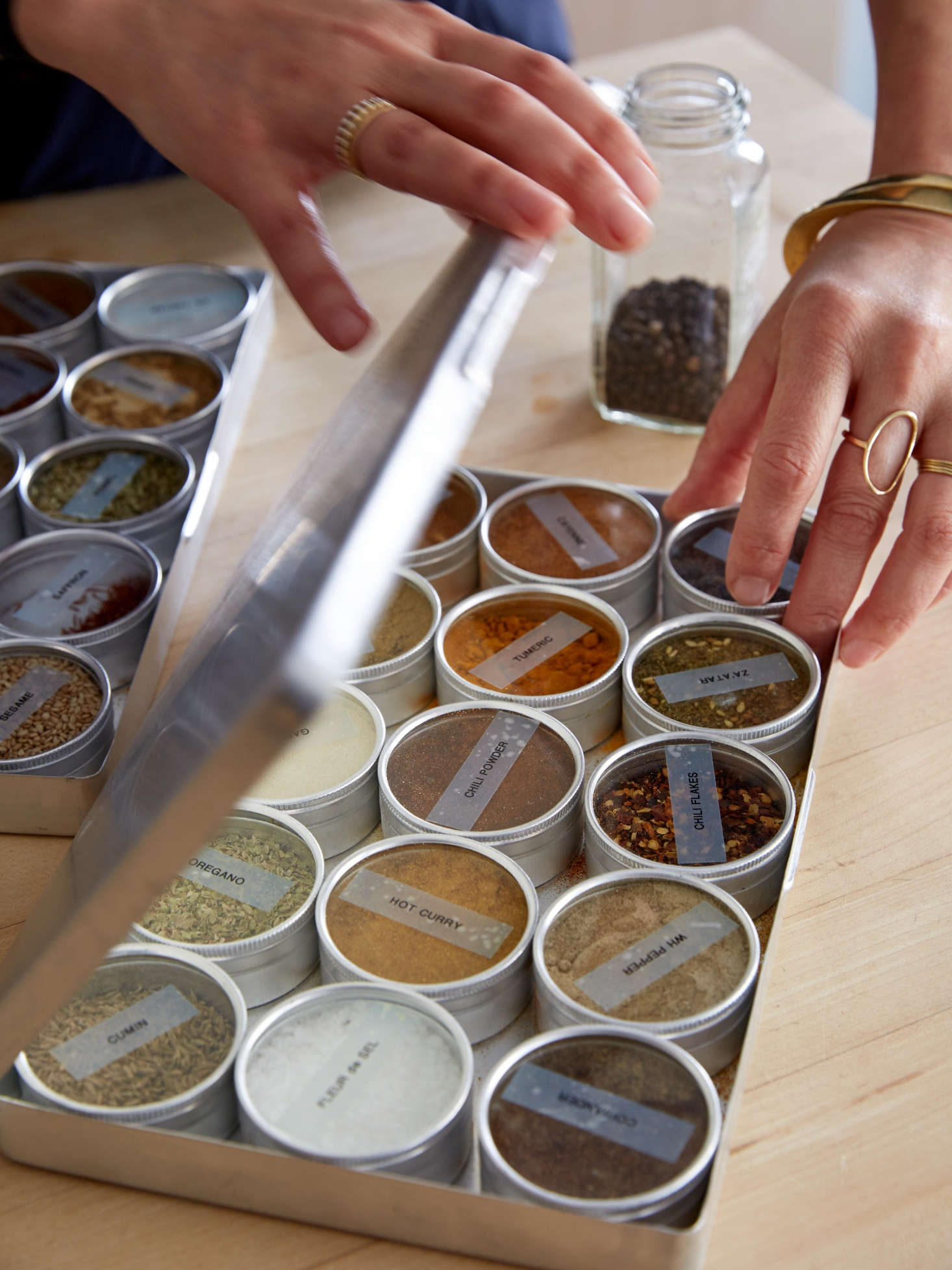 Spice storage idea for compact kitchens: tin boxes with glass tops