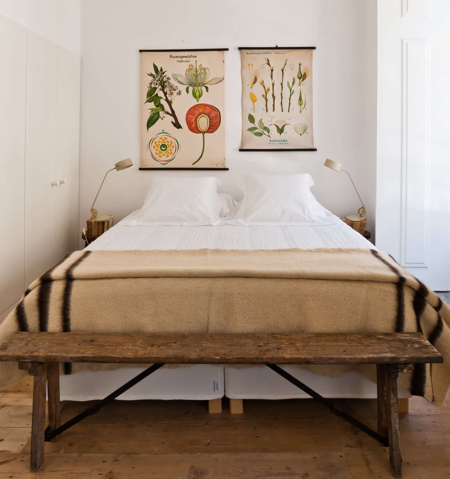 The owner of a Lisbon inn sourced bright botanical charts, originally from a German primary school, from a shop in Madrid and hung them as posters. SeeSteal This Look: A Portuguese Bedroom with Vintage Charm.