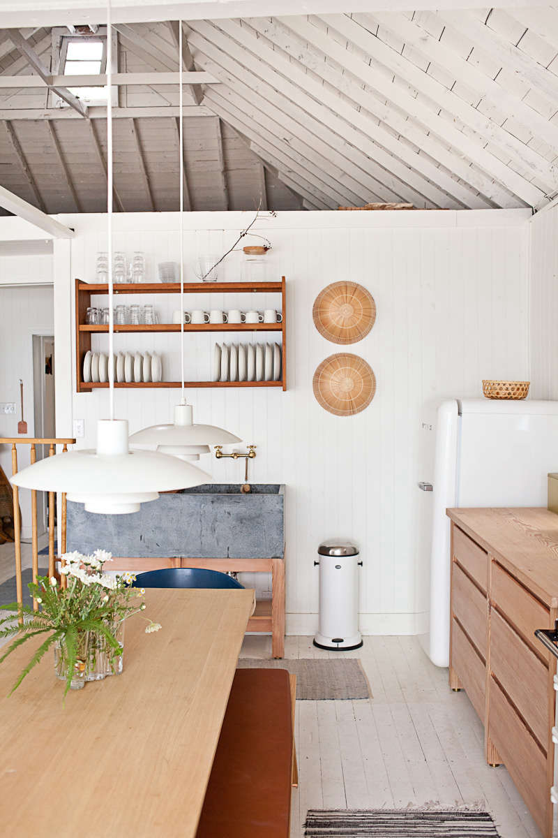 The floors in Mjölk's Renovated Scandi-Style Cabin on a Lake are also painted white, these in Benjamin Moore&#8