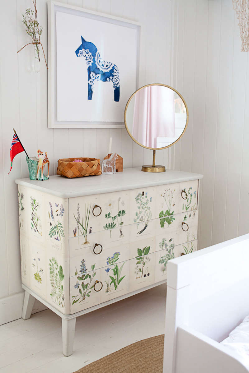 In a favorite Canadian summer cottage, a vintage dresser, found via a Swedish auction, is papered with botanical prints. For the full house tour, seeO Canada: Mjölk's Renovated Scandi-Style Cabin on a Lake. Photograph by Juli Baker.