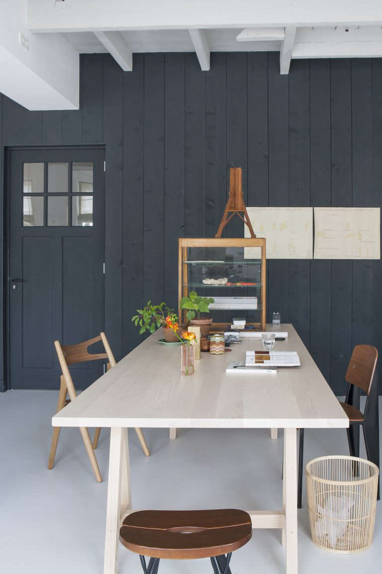 Christien Starkenburg, a furniture designer in the Netherlands, uses vertical wood paneling to emphasize the height of her small kitchen and dining area. Photograph courtesy of Anna de Leeuw from our post Kitchen of the Week: The Curtained Kitchen, Dutch Modern Edition.