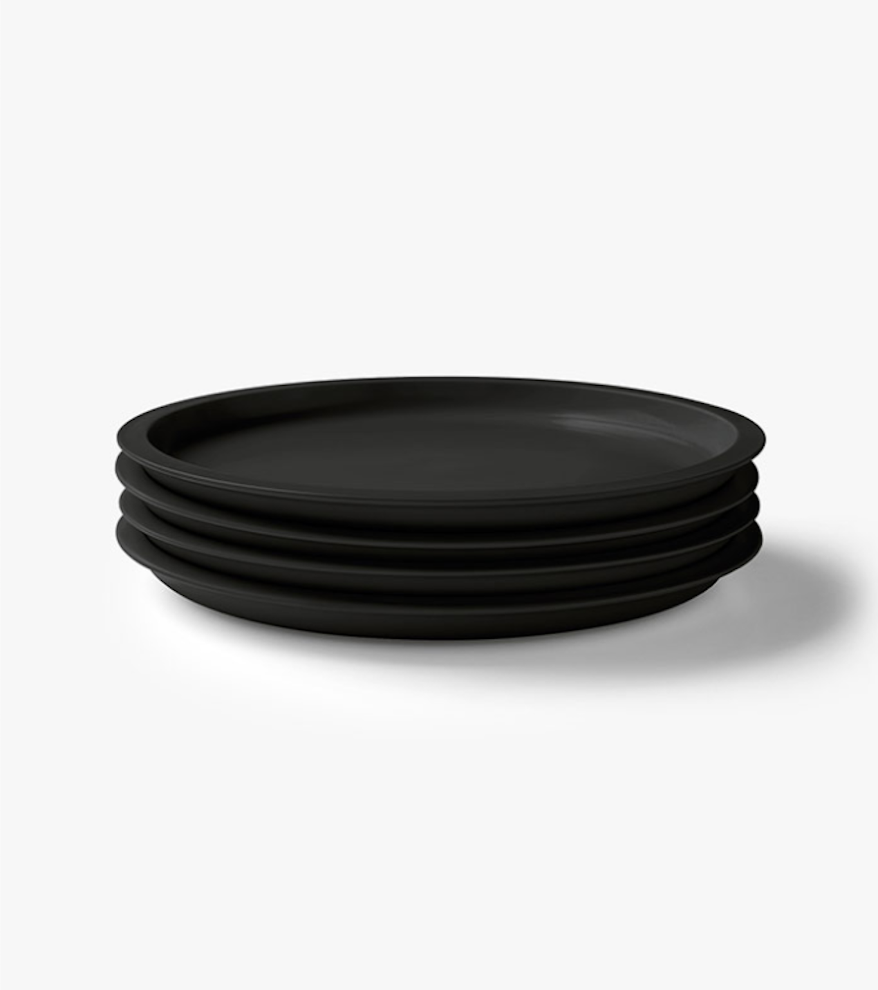 Black Kali Dinner Plate from Aura Home-kali-dinner-plate & 10 Easy Pieces: Dramatic Black Dinnerware - Remodelista