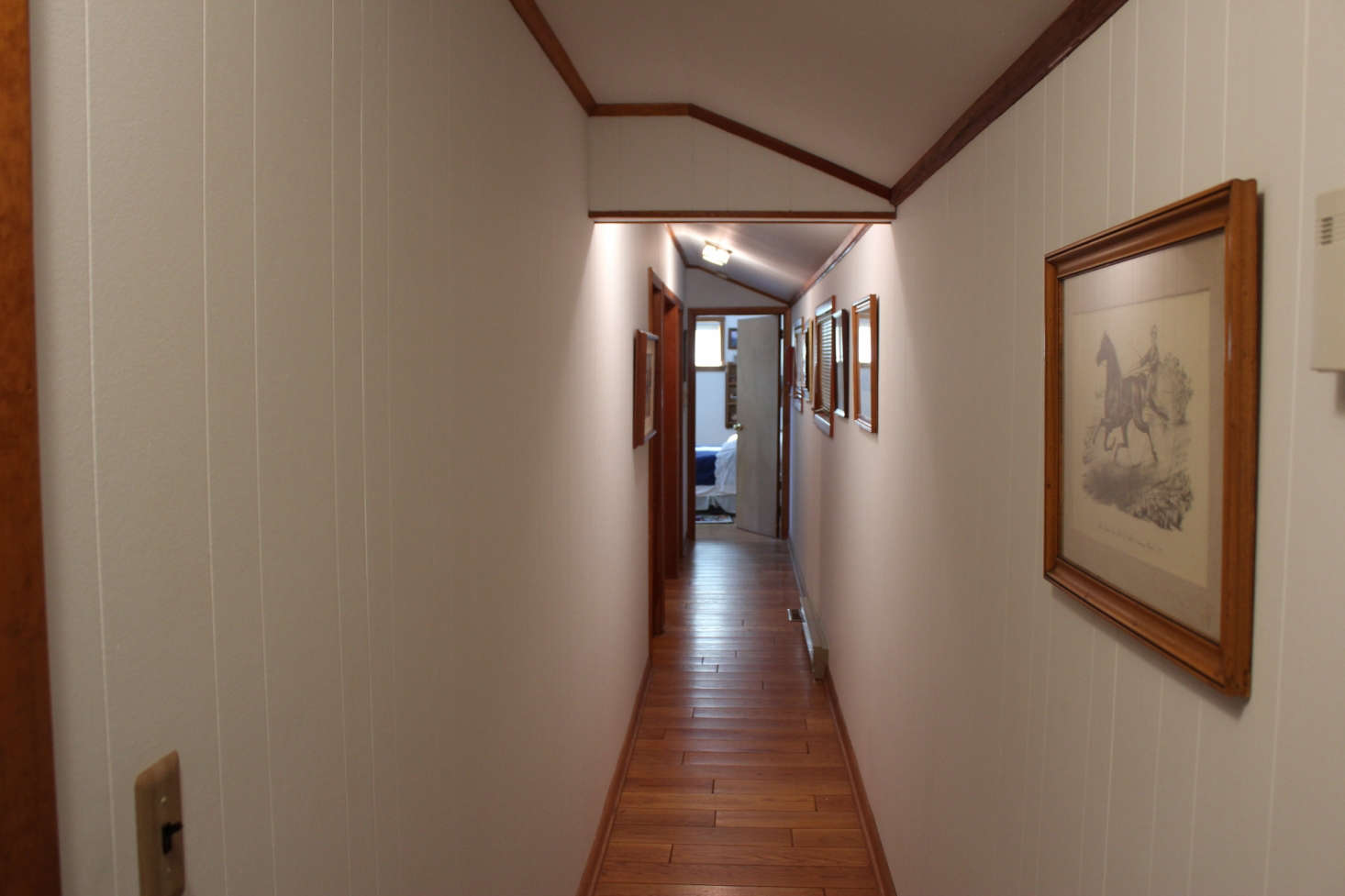 The hallway, pre-paint and concealed storage.