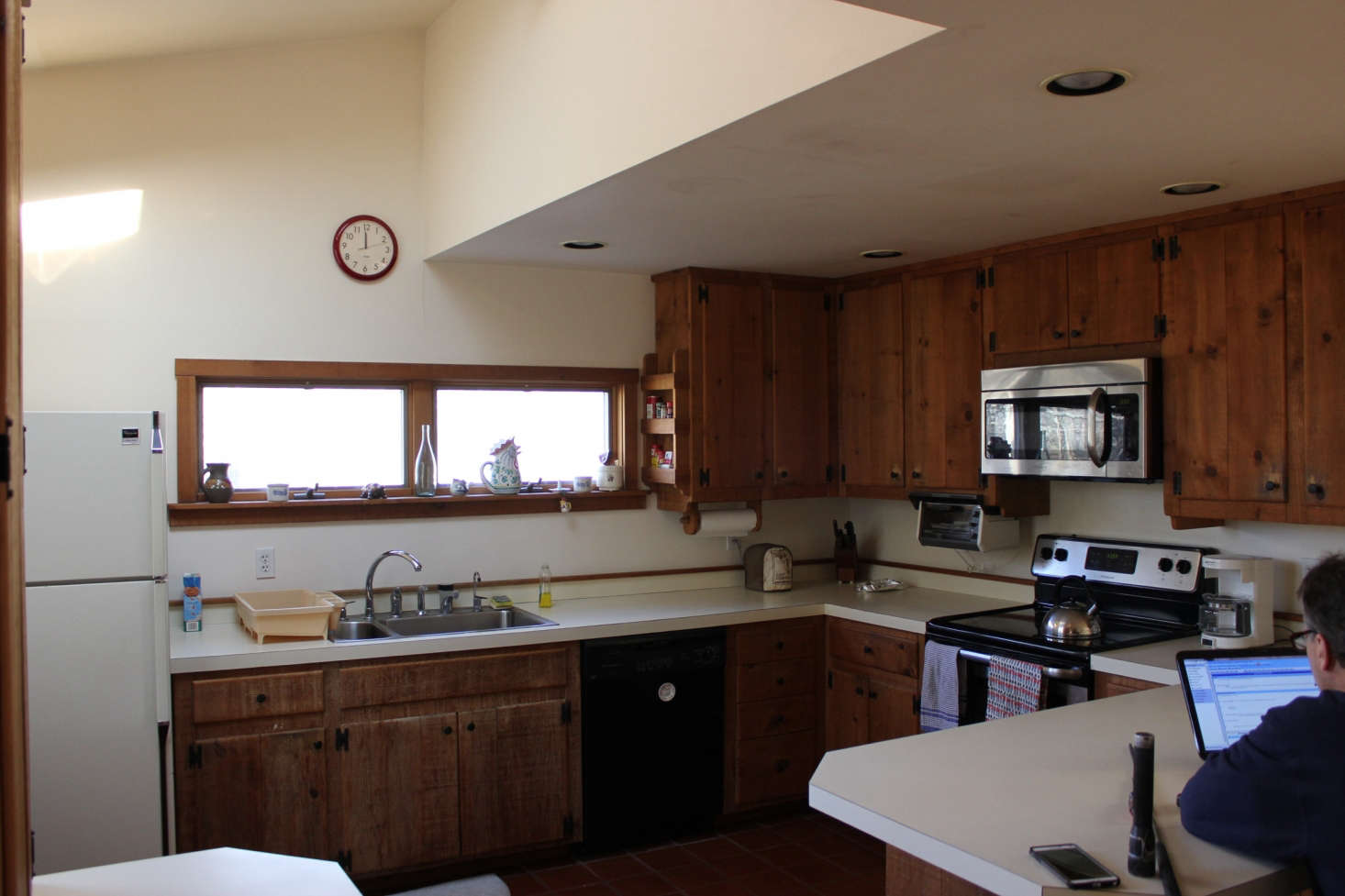 The kitchen, as it was. Jones opened up the enclosed space and replaced the heavy, dark cabinetry.