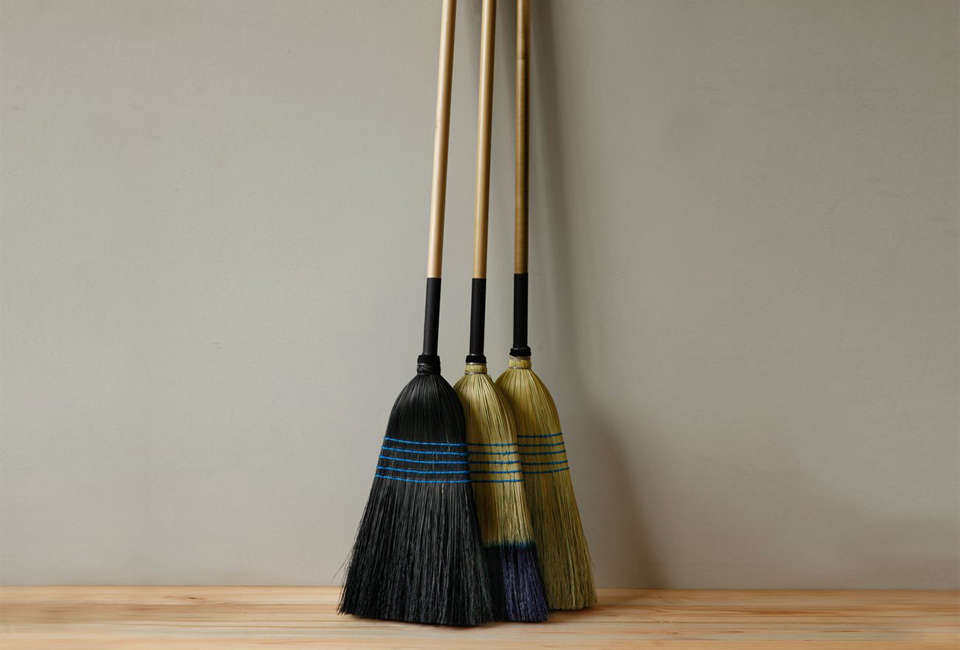 """These three corn huskBarn Brooms, in black, """"tipped,"""" and natural, are made in Pennsylvania by Lostine; $65 each from Lostine."""