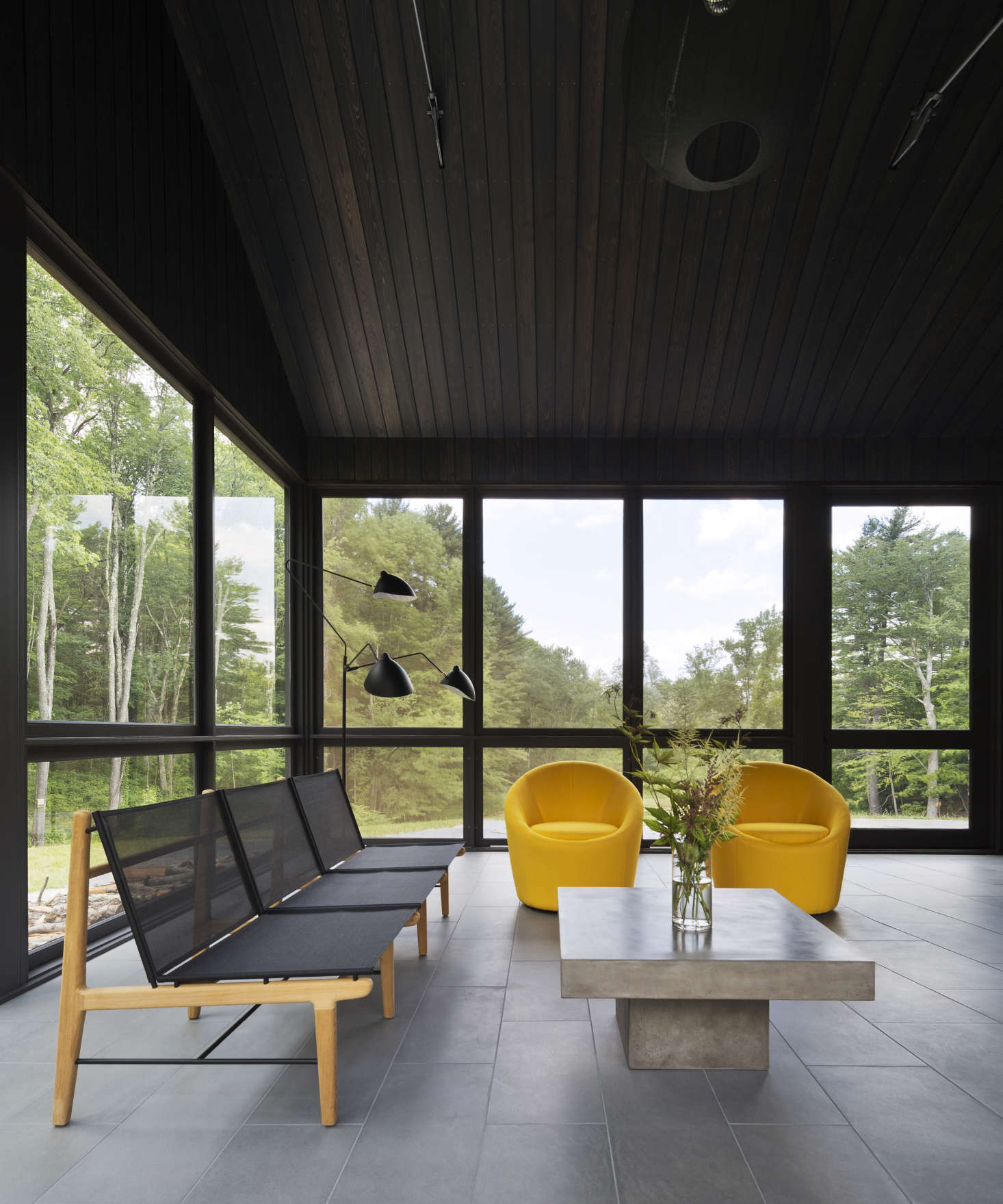 The porch at Undermountain, a barn-style house in the Berkshires by O'Neill Rose Architects