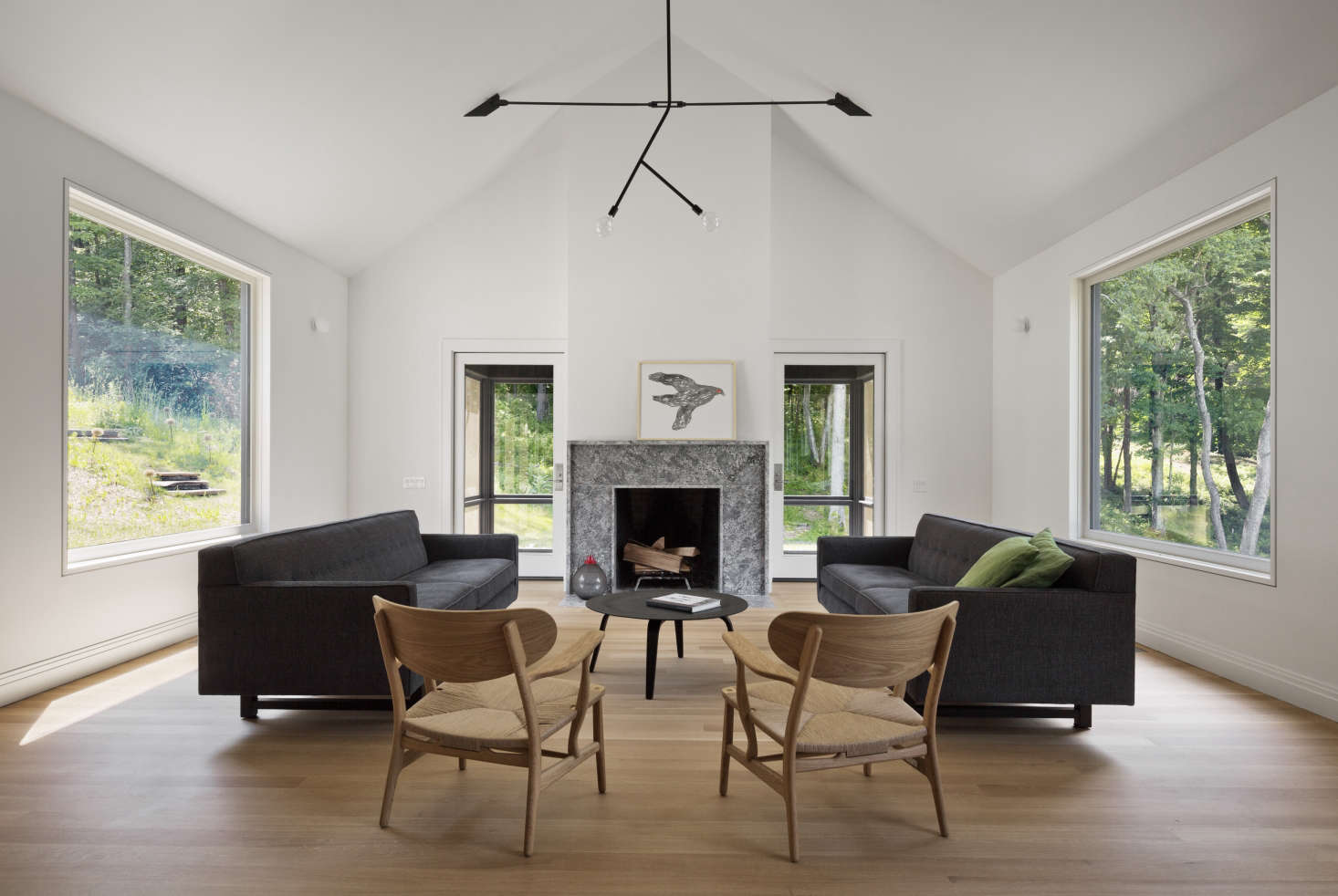 Peaked-ceiling living room at Undermountain, a barn-style house in the Berkshires by O'Neill Rose Architects