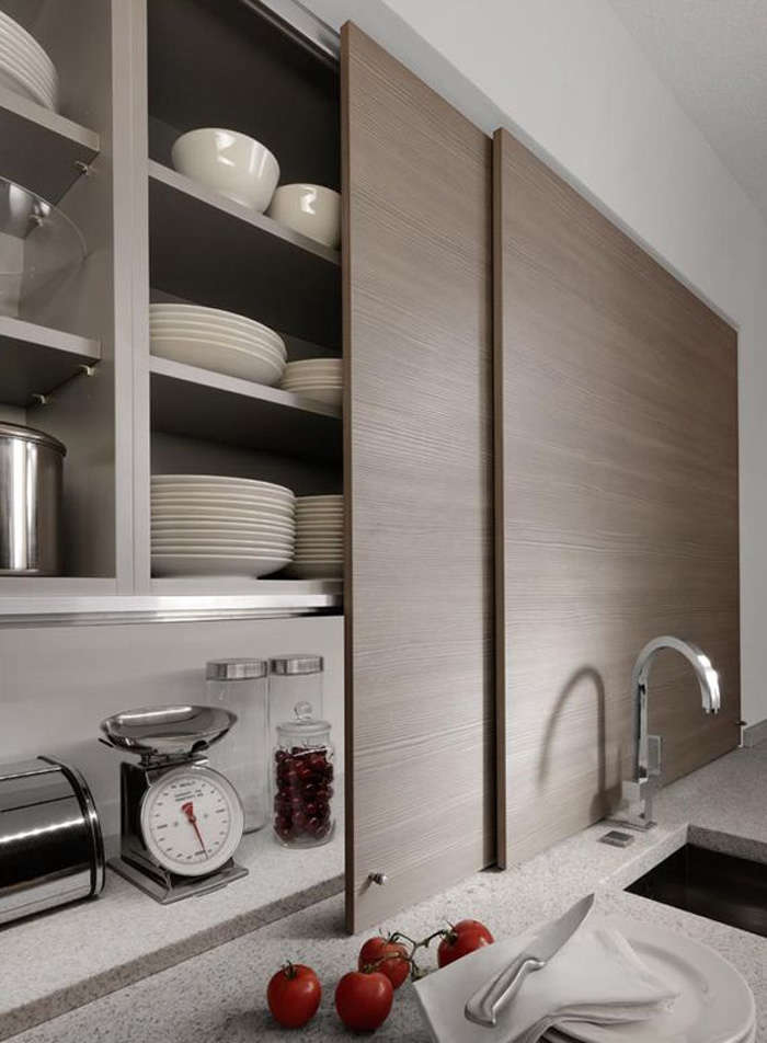Thin Sliding Cabinet Doors In A Kitchen By Germany Company Beeck Kuchen Conceal Countertop Clutter