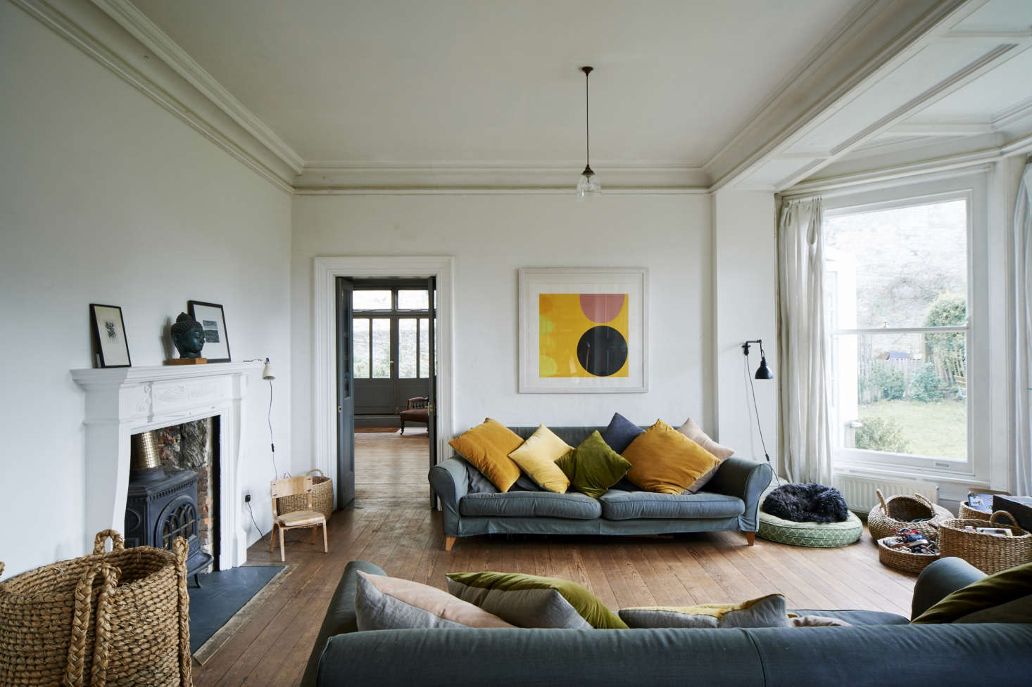 Kirsten Hecktermann's hand-dyed pillows in the living room of designer Niki Turner's house in Stroud, Gloucestershire.