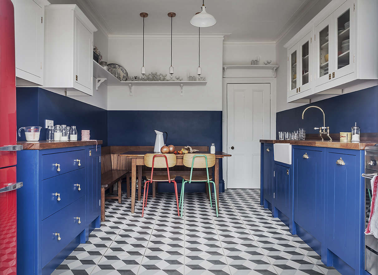 A booth-style seating area designed from antique church pews in the British Standard-designed kitchen from Kitchen of the Week: A Brightly Colored (and Cost Conscious) London Kitchen.
