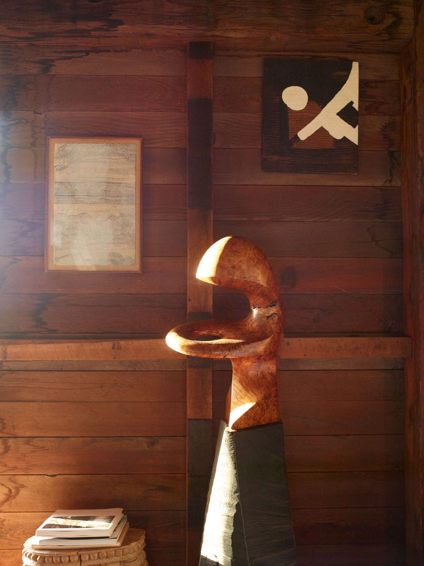 A wooden sculpture by the doorway.