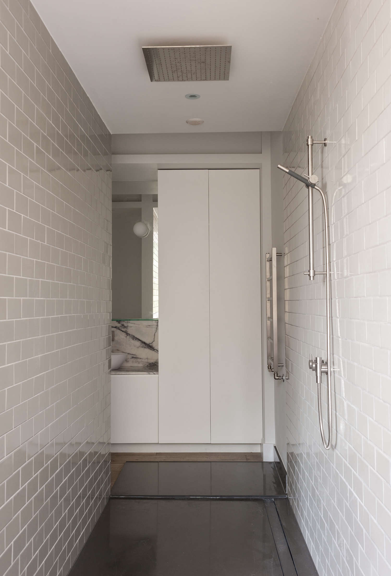 Bathroom of the week in london a dramatic turkish marble walk through shower with light gray subway ceramic tile dailygadgetfo Gallery