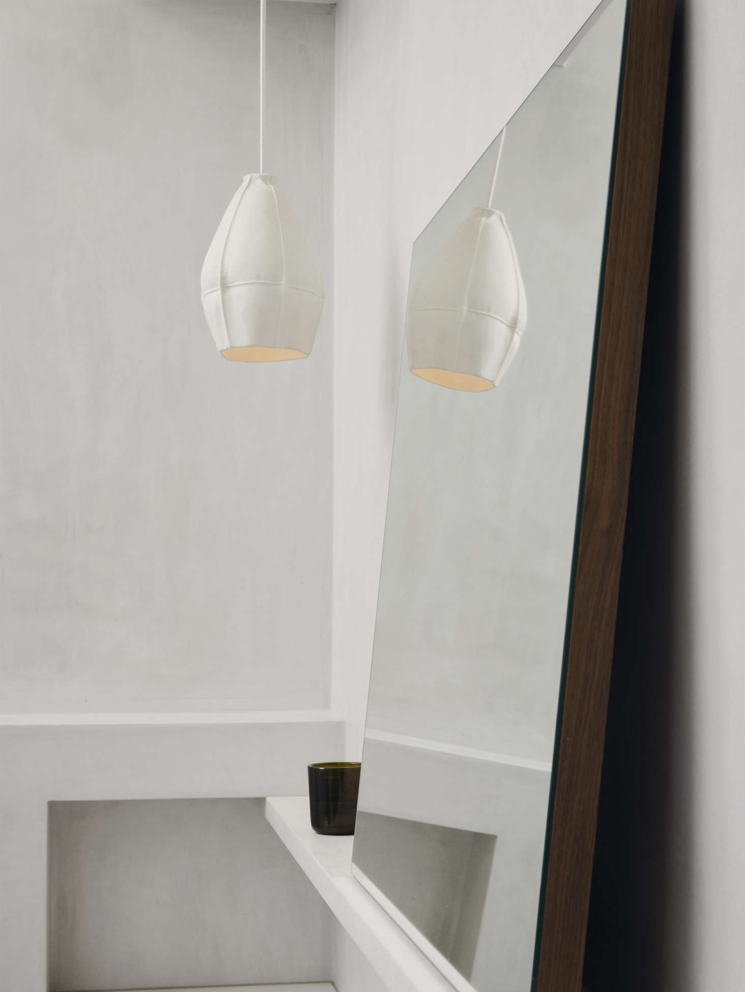 Vintage white plaster wall finish bathroom with pendant light and mirror