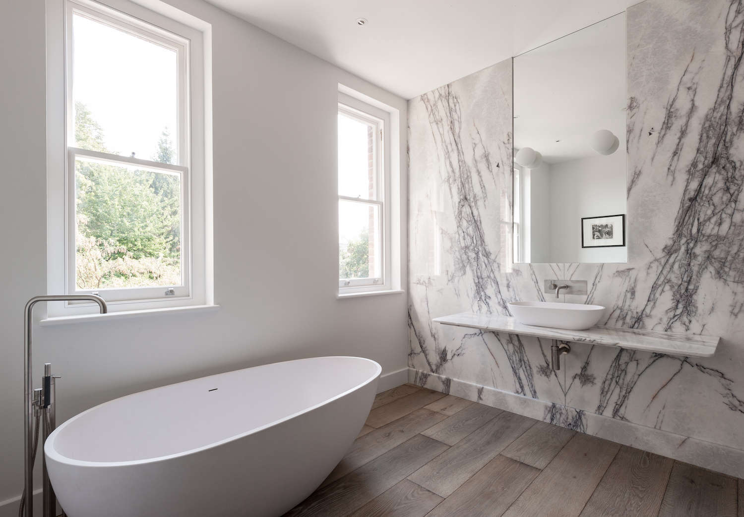 White marble slab bathroom with contemporary freestanding bathtub