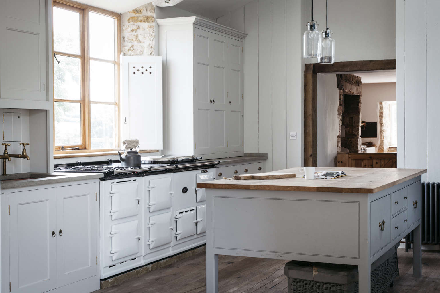 farmhouse kitchen cabinets. A modern spin on a classic English kitchen in Dorset farmohuse by Plain  Kitchen of the Week The Power Numbers