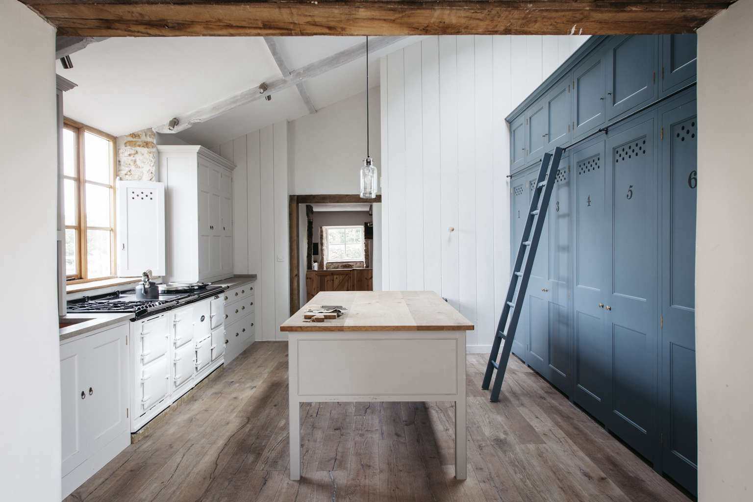 farmhouse kitchen cabinets. Blue kitchen cabinets in a modern spin on classic English by  Plain Kitchen of the Week The Power Numbers