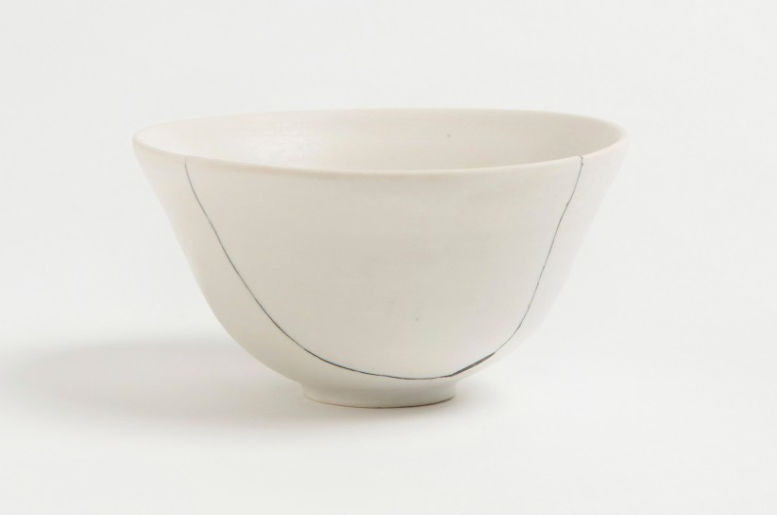 Above: As seen in White Fracture Bowl No. 3, New York–based British ceramist Romy Northover opts for a more updated look, replacing traditional gold seams with black putty; £188 at The Garnered.