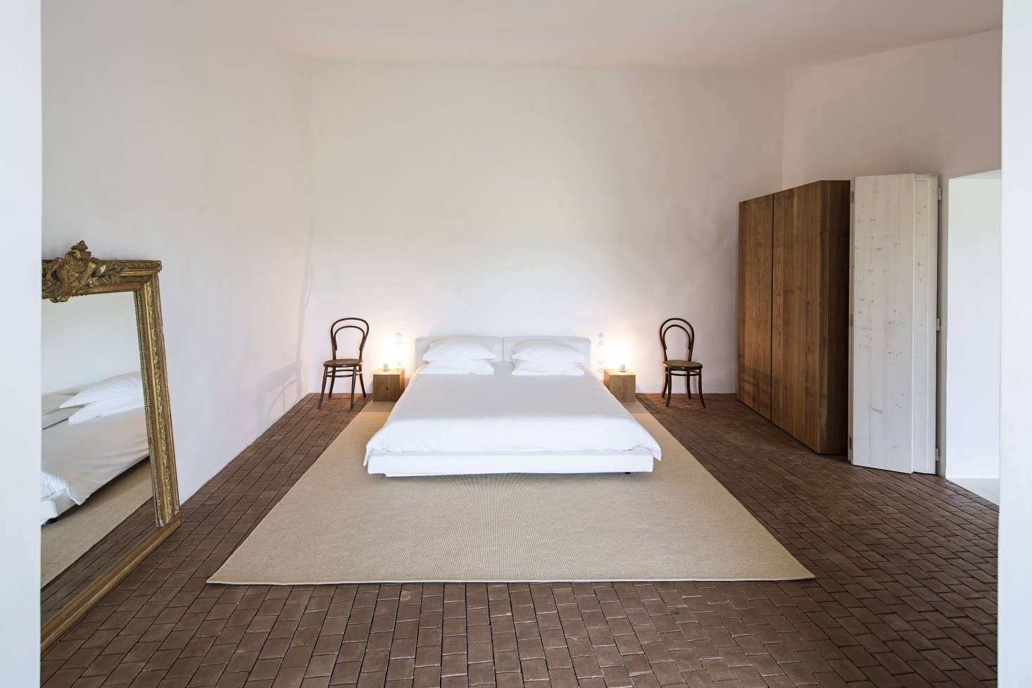 Terracotta tile in situ at Casa No Tempo: A Minimalist Retreat in the Portuguese Countryside.