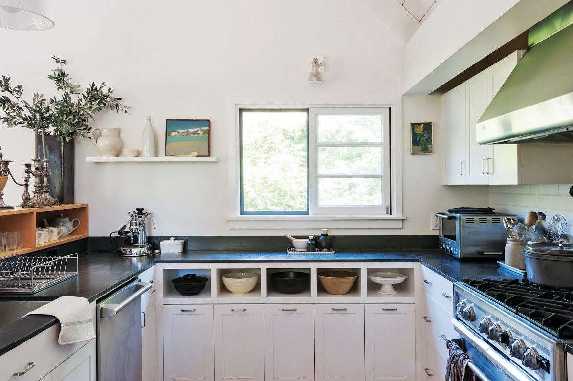 Julie created a vignette of art and white-toned ceramics in her Mill Valley, California, kitchen. Photograph by Matthew Williams for Remodelista; see more in Remodelista: A Manual for the Considered Home.
