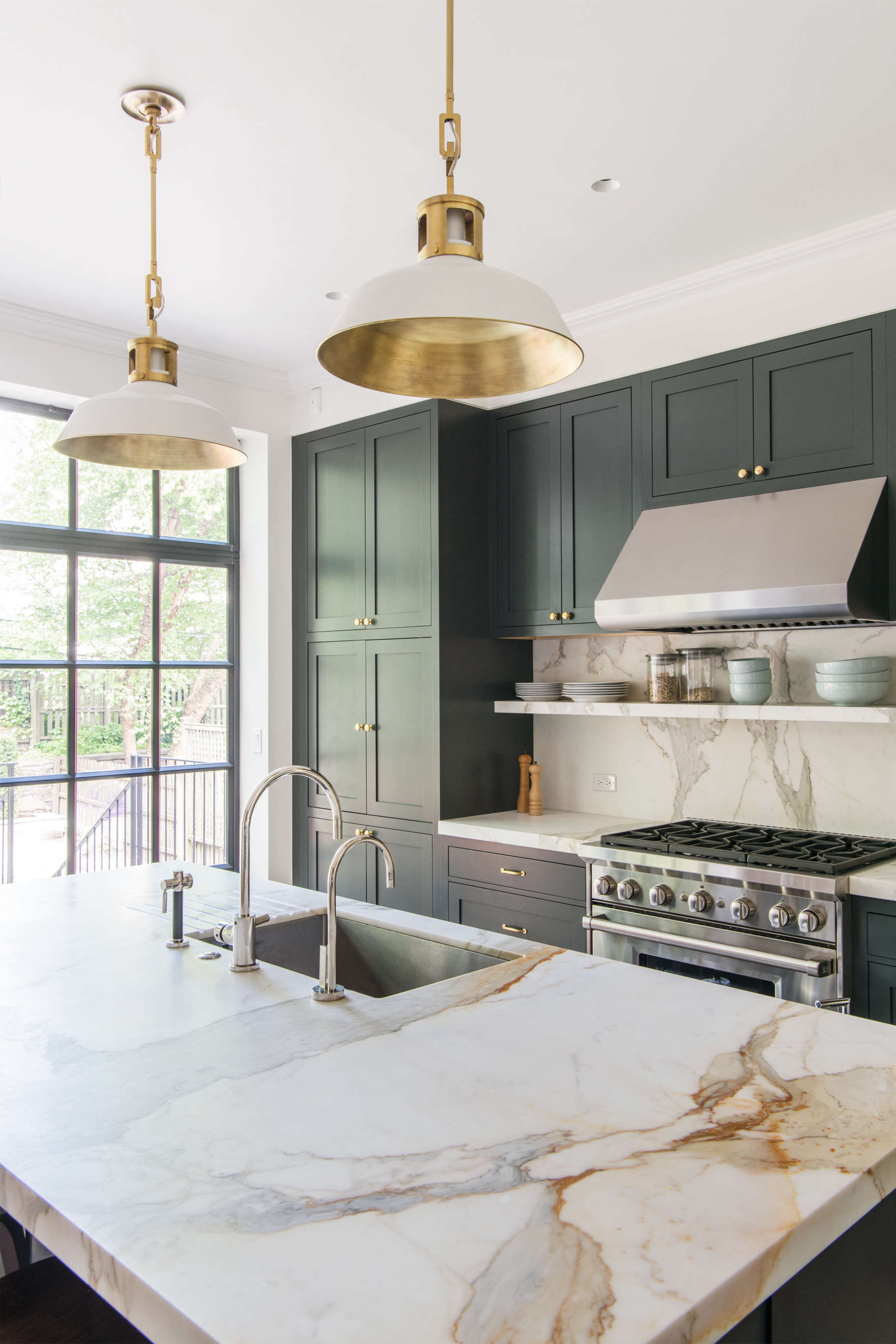 Kitchen With Marble Countertop Pendant Lights Green Blue