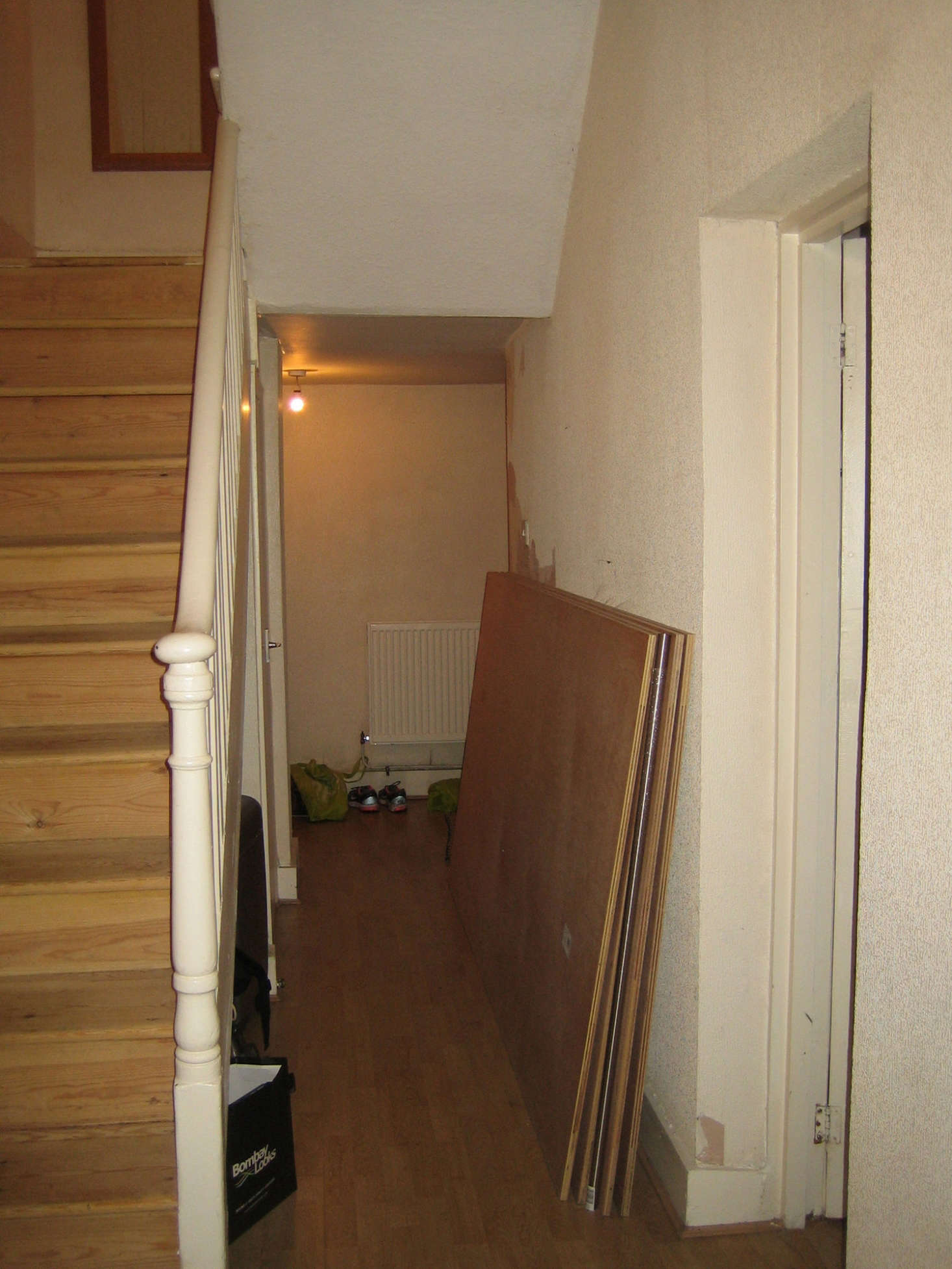 Pre-remodel, there was a narrow hall and rebuilt stair.