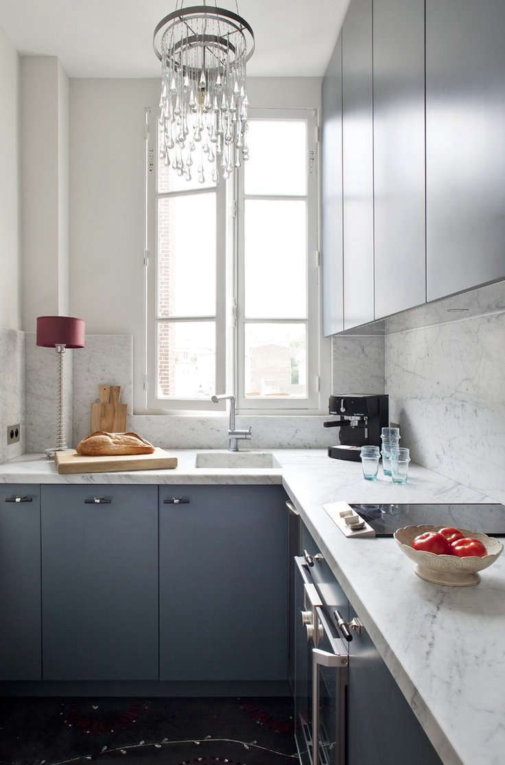 In her pied-à-terre in Paris, Ochre designer Solenne de la Fouchardiére dresses up her kitchen with marble counters and backsplash, and Ochre&#8