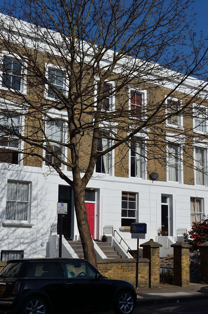 The maisonette(with red door) is part of a terrace house, a historic brick row building with what Johnston describes as a &#8