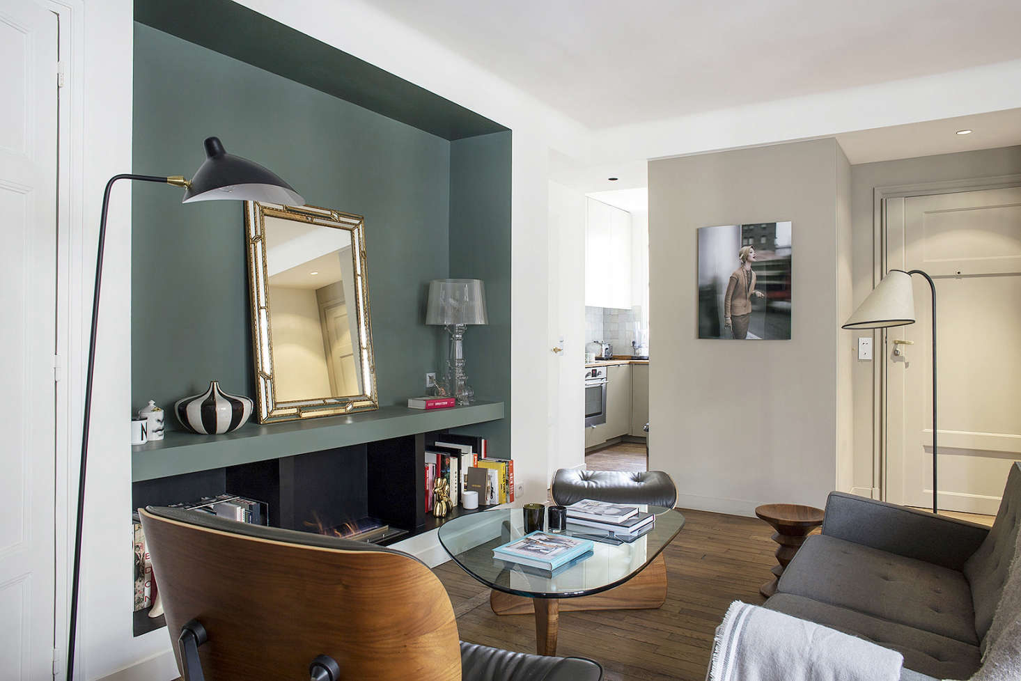 small apartment living room. A flea market mirror in the niche adds dimension  as does vintage Roger Prigent 9 Small Space Ideas to Steal from a Tiny Paris Apartment