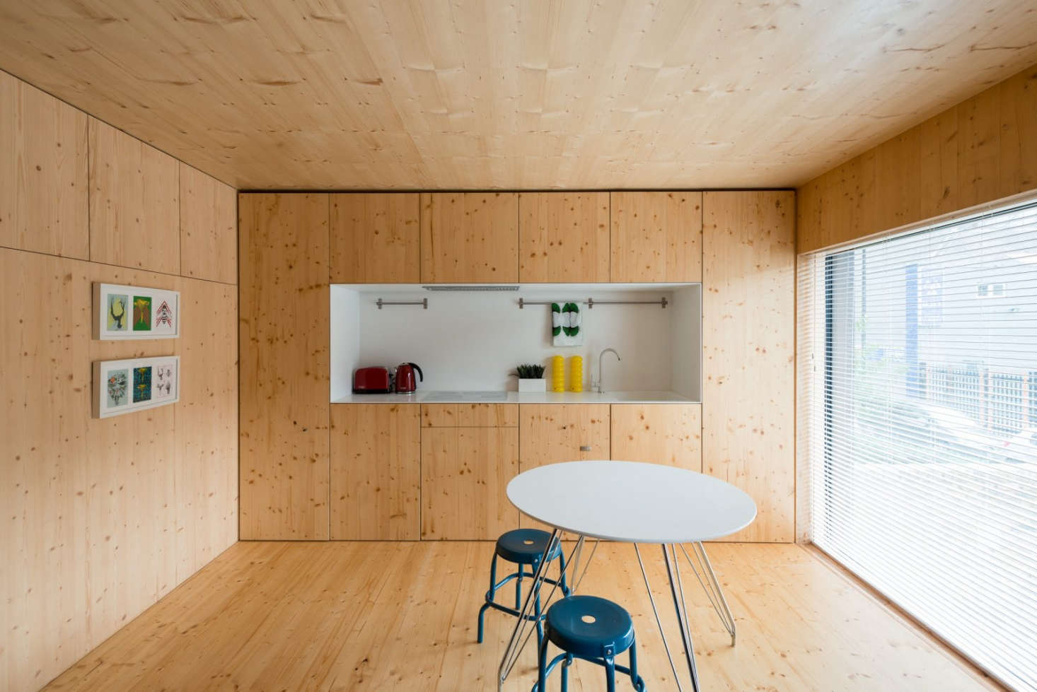 A kitchenette with hidden appliances in a 45src=
