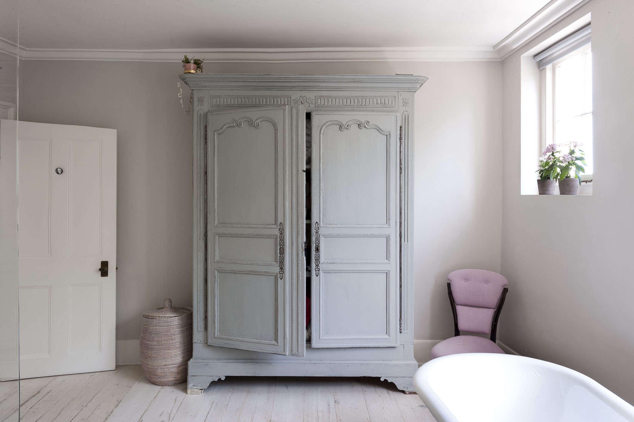 antiqued-blue-armoire-michelle-mckenna-bath-uk-pink-chair