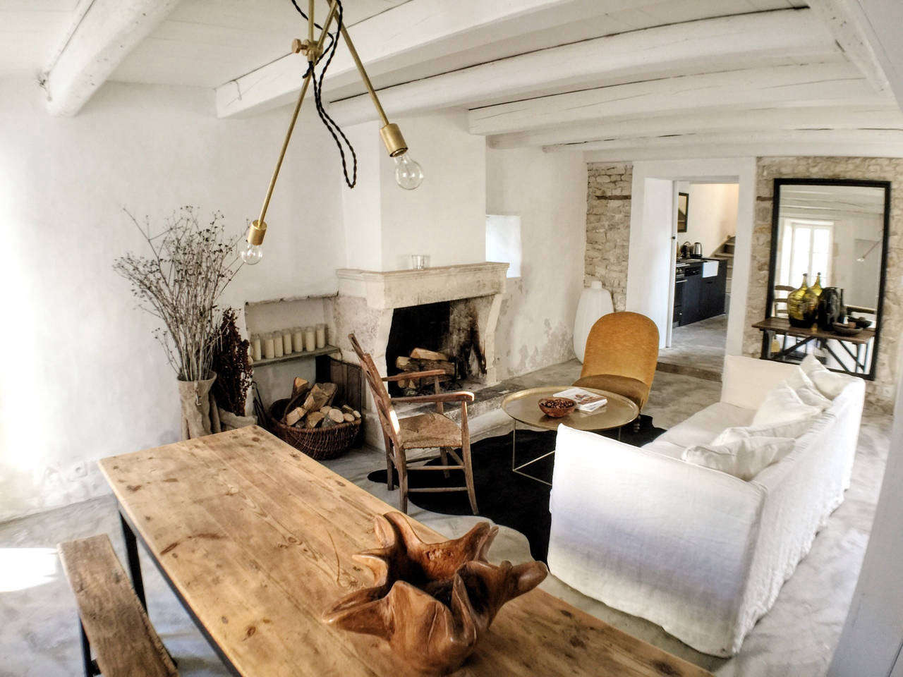 Living room furniture at la maison du figuier is centered around the old fireplace while extra