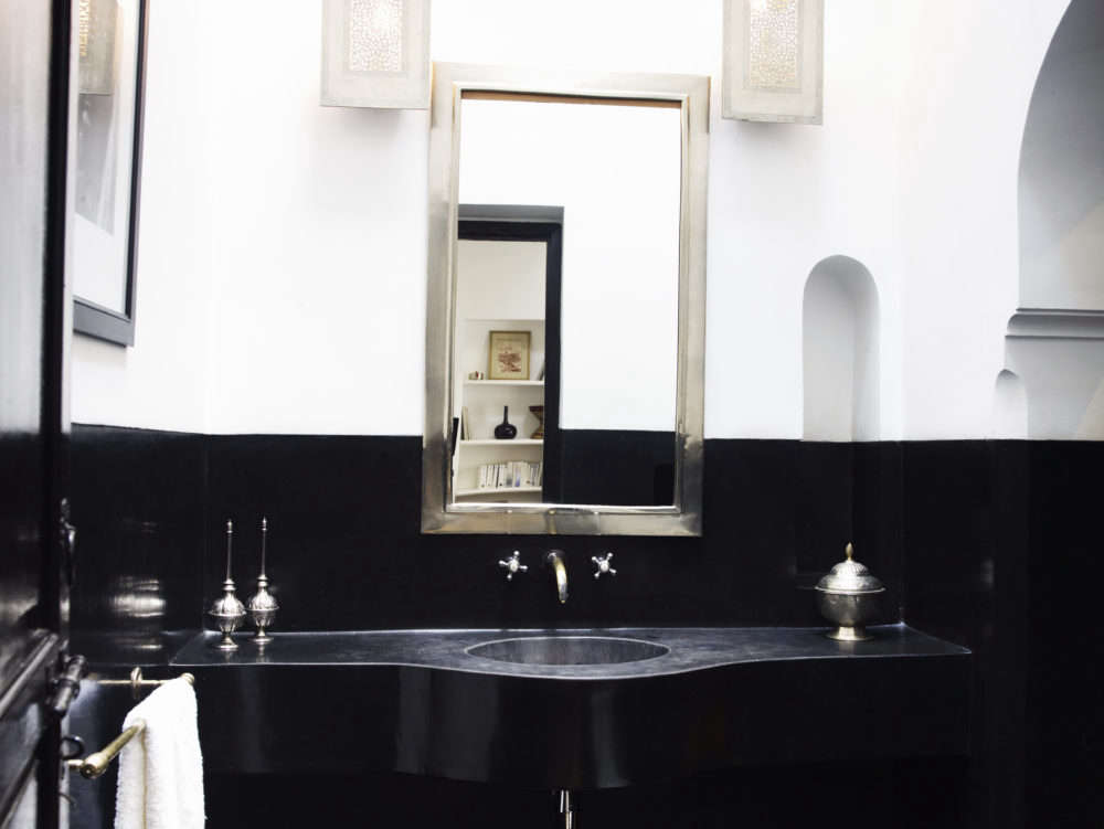 A bathroom at L'Hotel Marrakech, designed and owned by Jasper Conran, is lined in black tadelakt and white stucco. See more in A Romantic Riad from UK Designer Jasper Conran.Photography courtesy of Jasper Conran.
