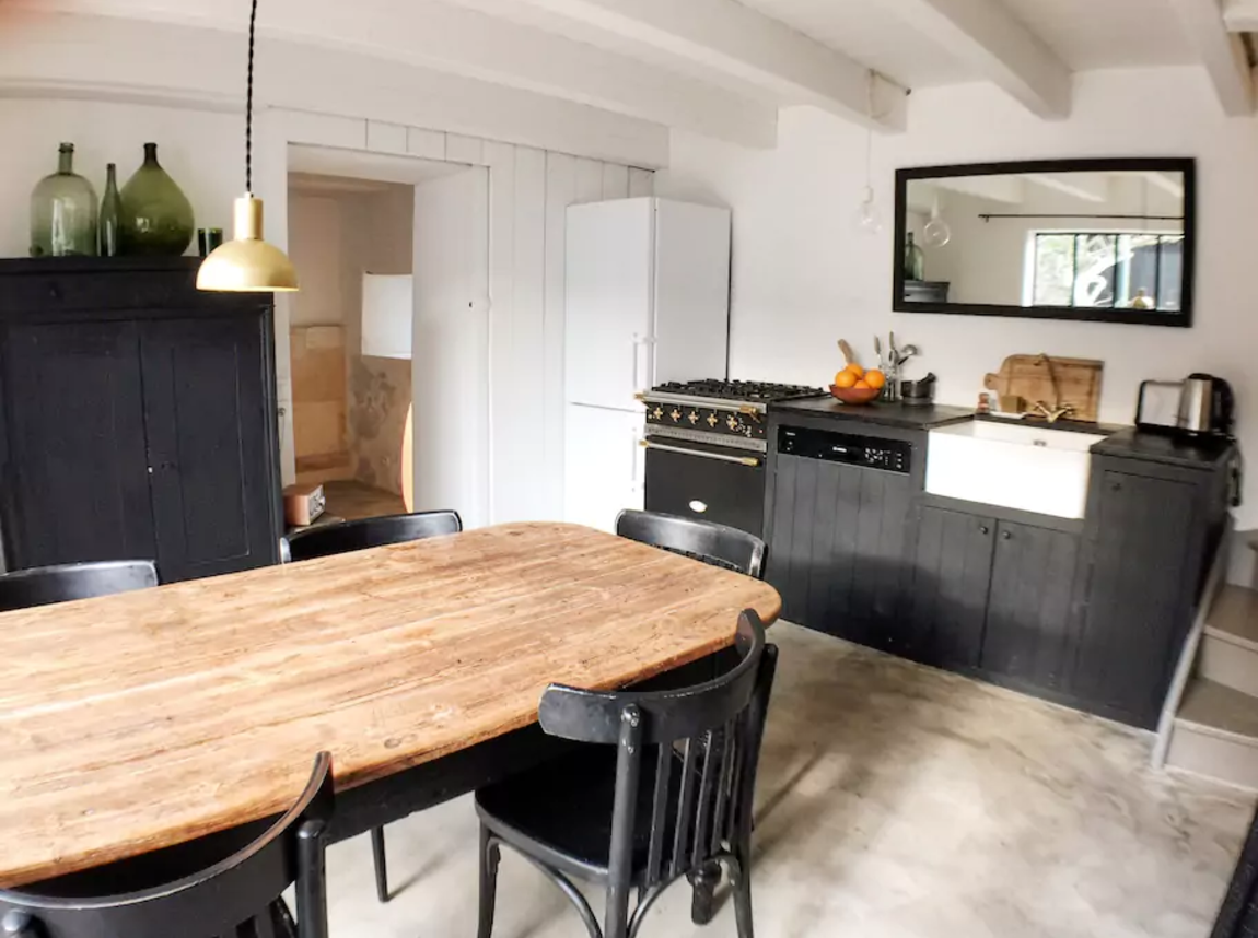 We love the rustic eat-in kitchen at La Maison du Figuier, an AirBnB on France&#8