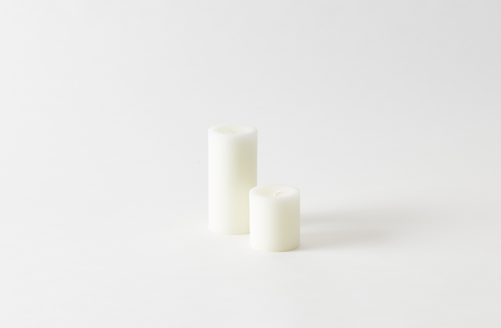 Hand-Poured White Pillar Candles are $18 for the large size at March. Alternatively, West Elm's Unscented Pillar Candle is $7 for the three-by-six-inch size.