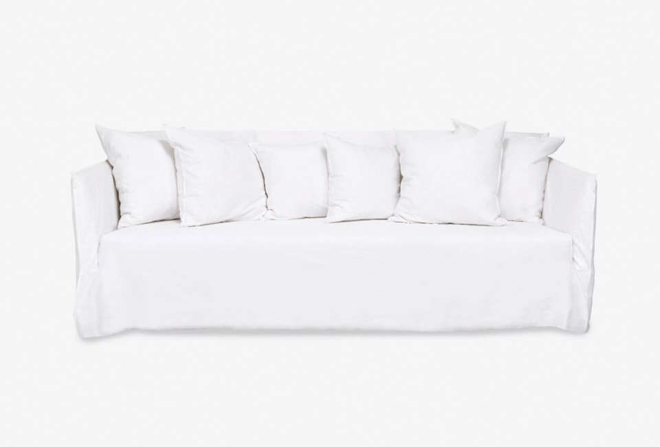 TheGhost Linen Sofa is by Italian designer Paola Navone for Gervasoni. For a similar look, see theElm Sofa from Cisco Brothers. For more, see our post 10 Easy Pieces: The Perfect White Sofa.