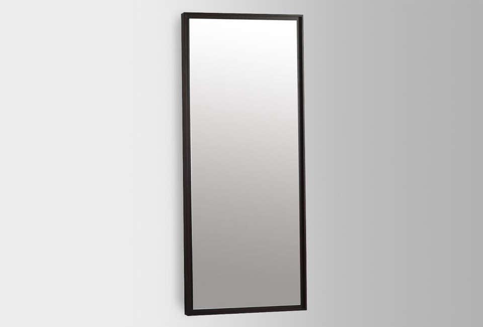 The Floating Wood Floor Mirror, shown in black, is $399 at West Elm.