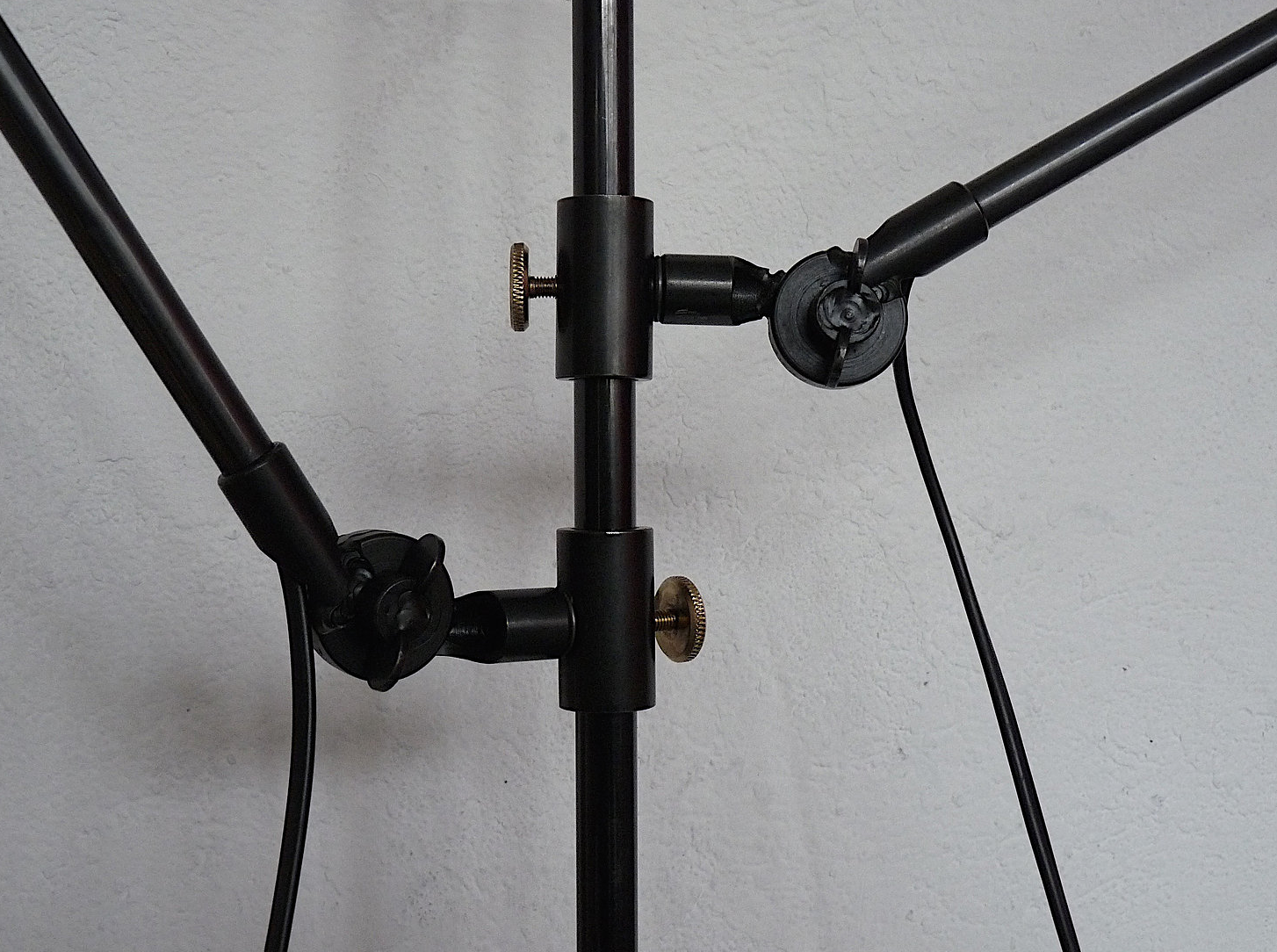 A detail of the Anvers Two Arm Lamp's adjustable blackened steel and brass joints.