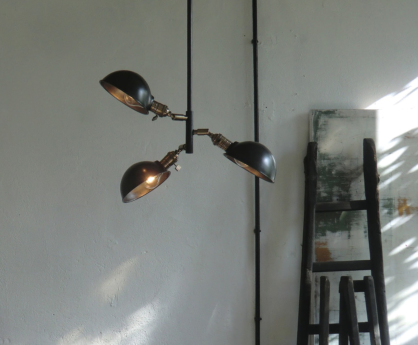 The Auguste Three Lights Ceiling fixture is €659 ($700), shown here with steel cup shades.