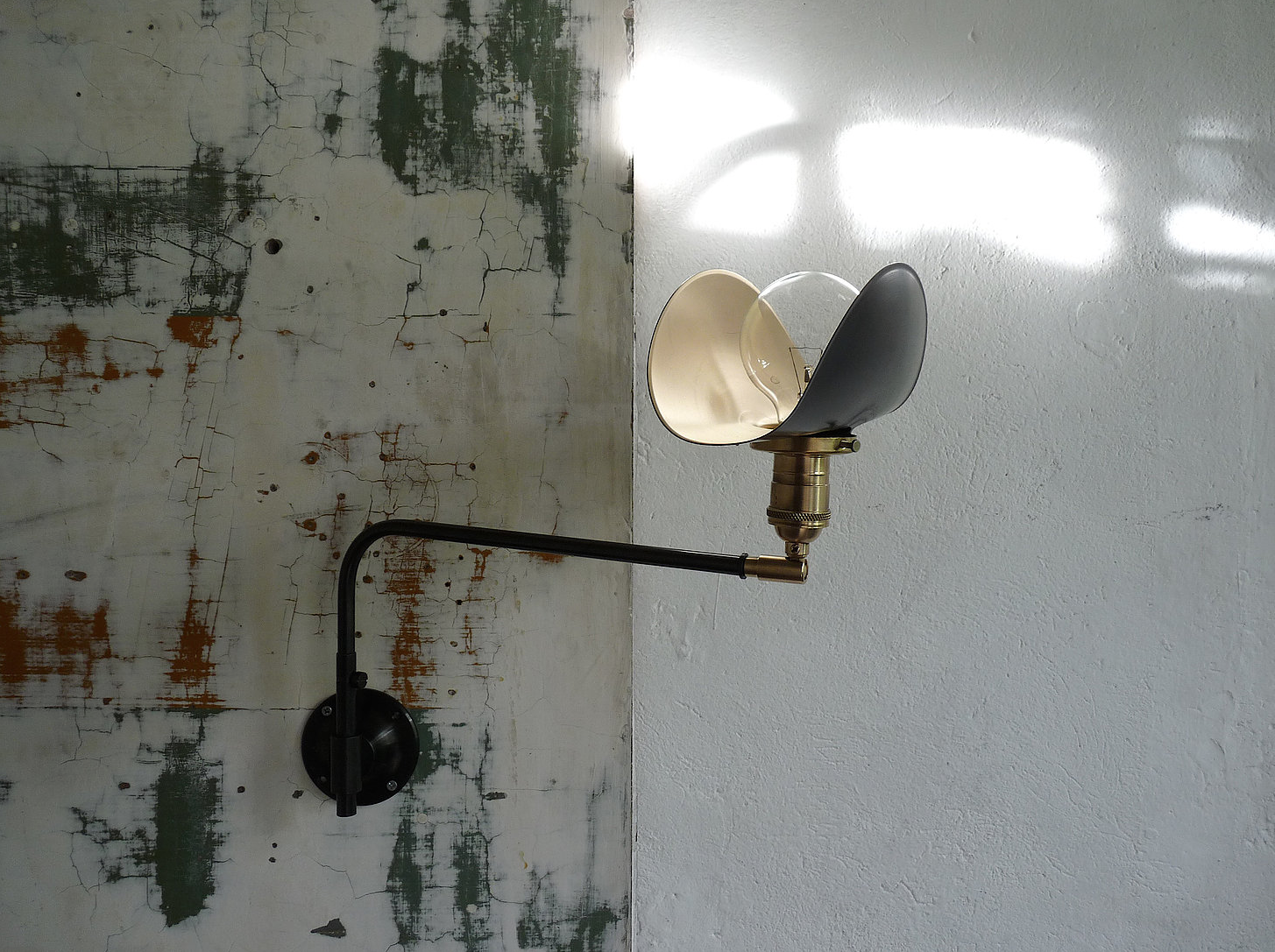 The petite Marianne Swing Wall Lamp has a brass switch socket; €425 ($451).