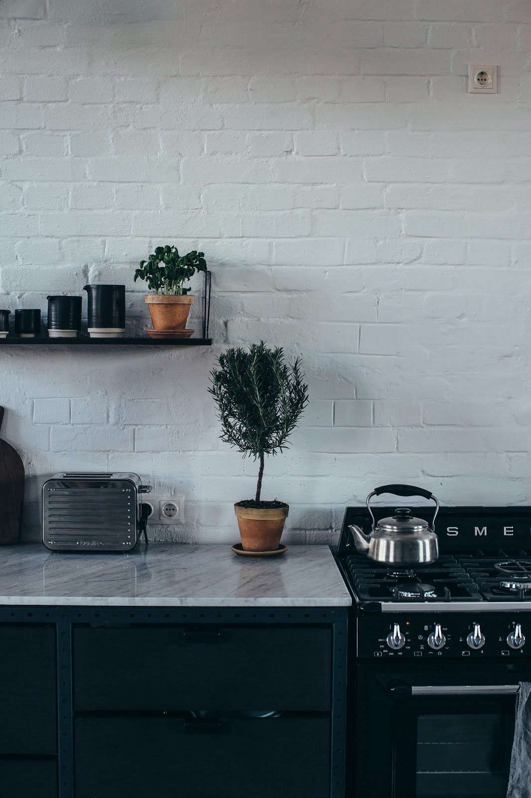 "Frama kitchens incorporate top-of-the-line appliances, while, as the company puts it, ""retaining a low-tech and analogue expression."" The range is a Smeg."
