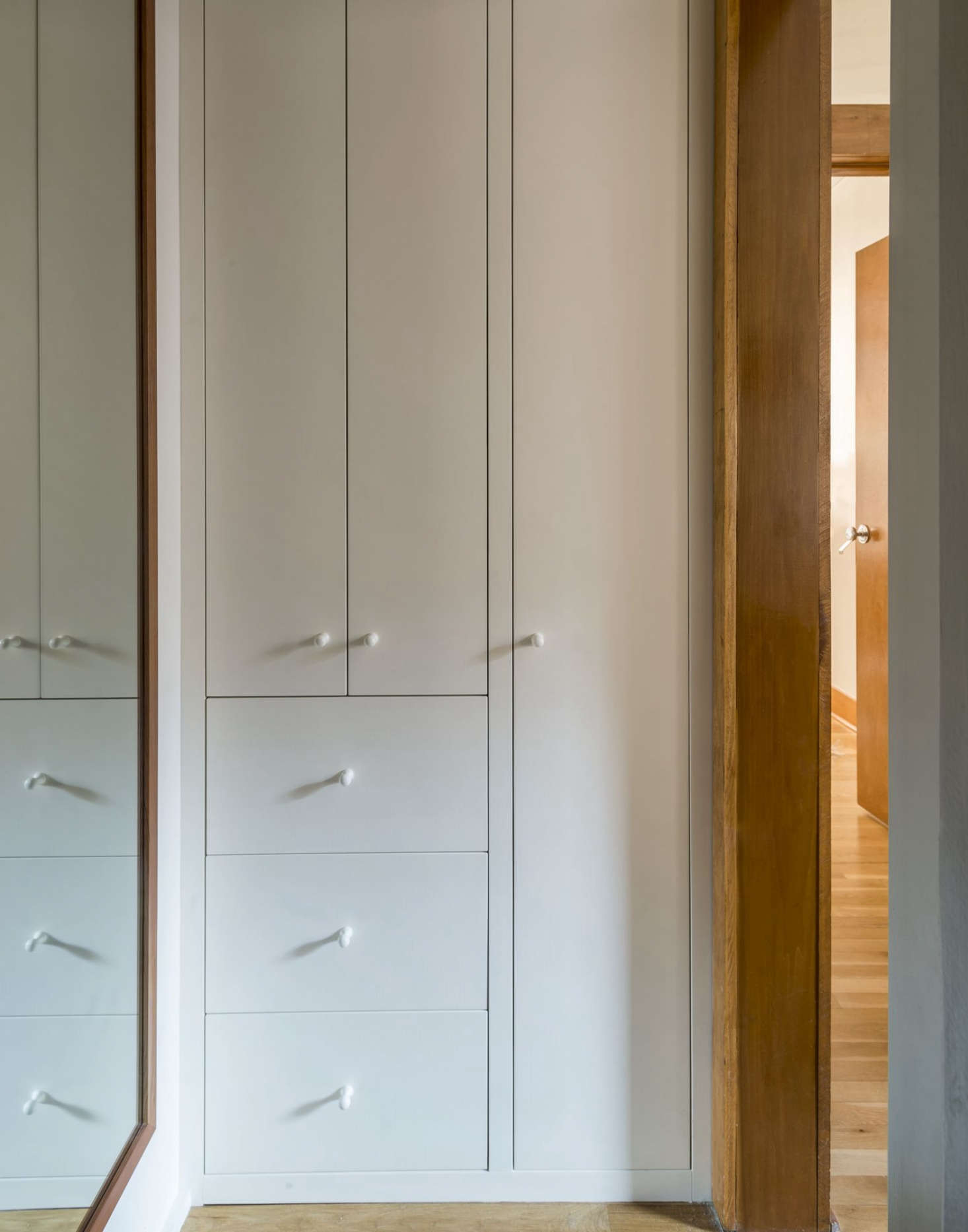 Vintage An anteroom outside the bath is now a linen and utility closet The tall cabinet