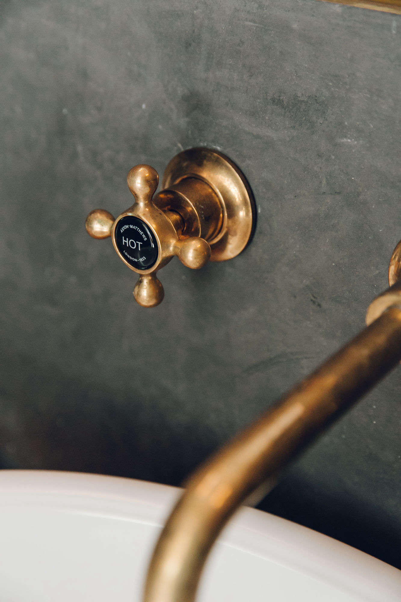 The brass faucet is fromBarber Wilsons & Co.