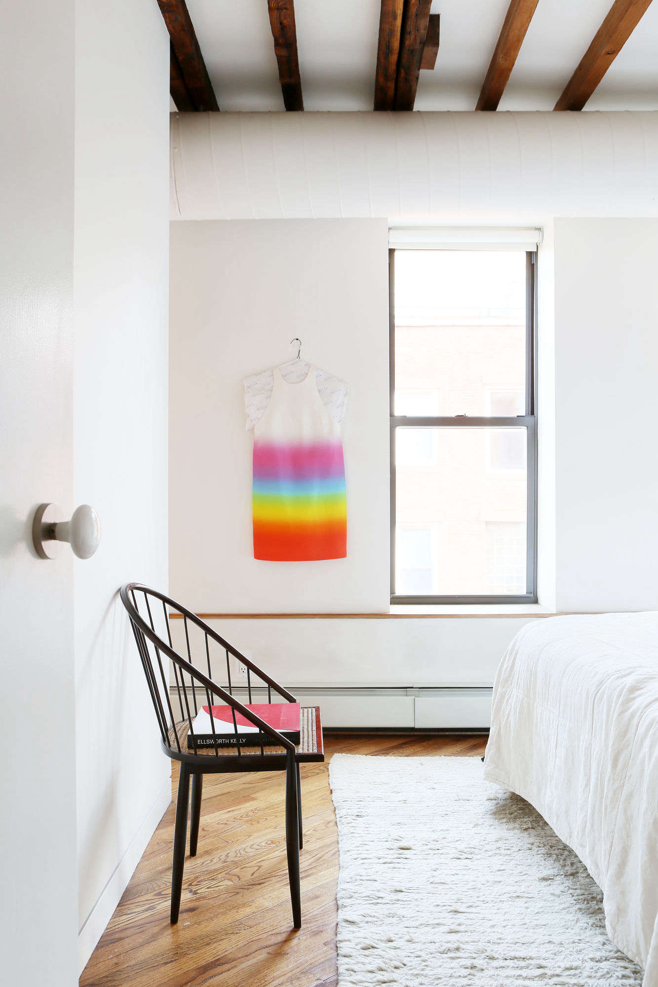 The all-white bedroom gets a burst of color with one of Javitch&#8