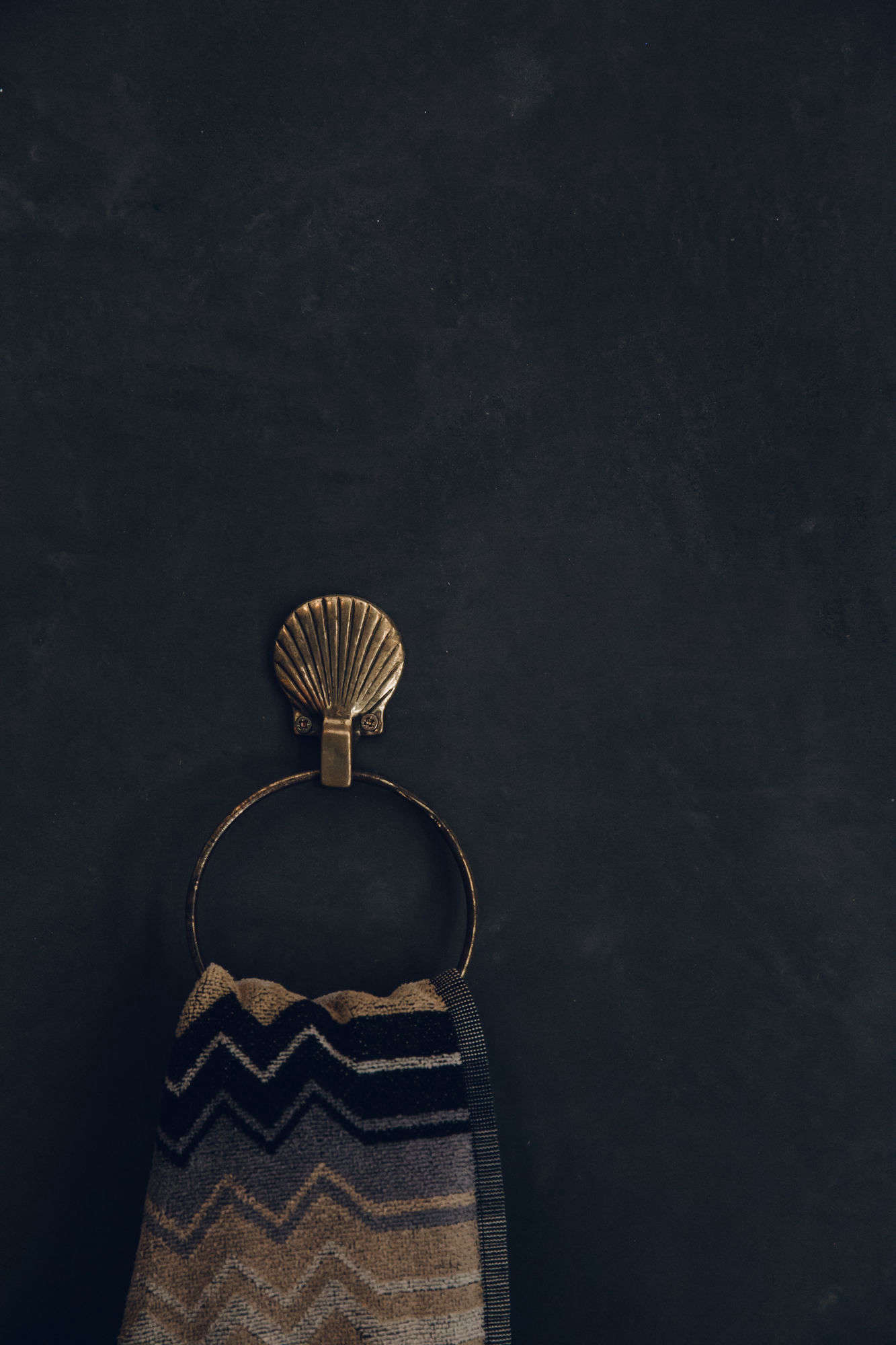 A vintage seashell towel ring is one of several nods to nautical design.