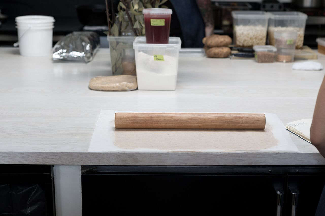 The center island countertops are bleached white oak.