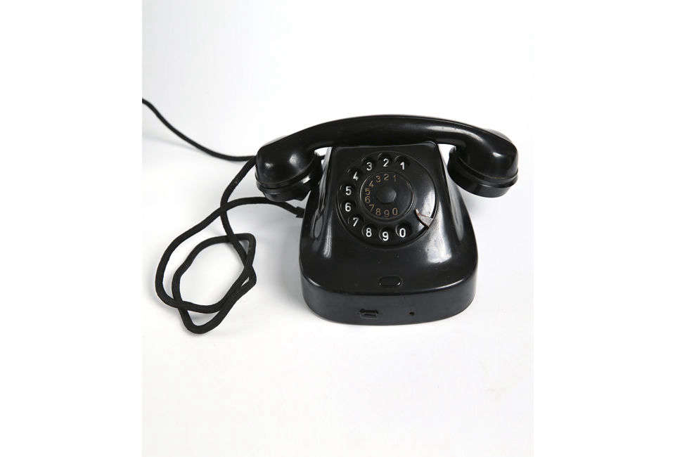 Source a Vintage Rotary Black Telephone like this one for $35 from Etsy store MM Vintage Store in Bulgaria. Alternatively, Bold Old Phones sells an array of 60s and 70s phones in different colors.