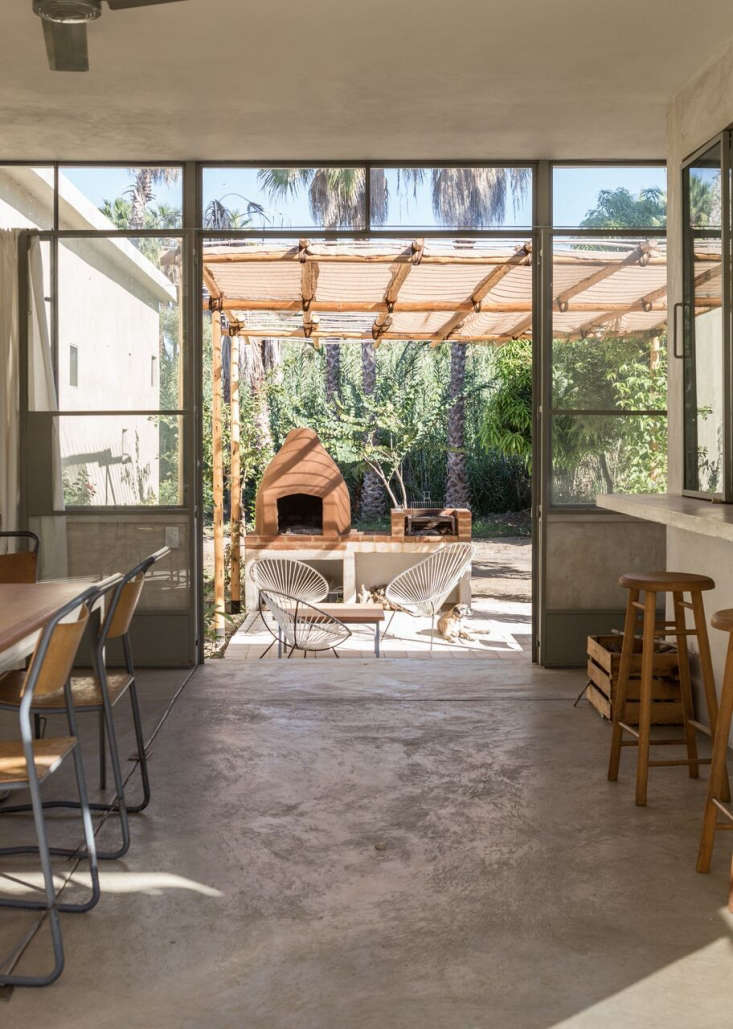 The Kitchen Opens Onto A Shaded Outdoor Lounging Area With Acapulco