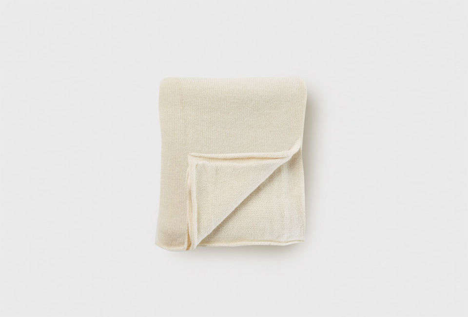 The Lauren Manoogian Baby Alpaca Double Wide Blanket in white is $4 at Jenni Kayne.