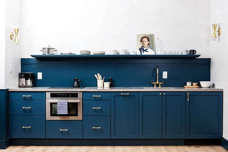 A kitchen in Philadelphia hotel Lokal by Jersey Ice Cream Co., with cabinets painted in Sherwin Williams's Seaworthy. See more in Trend Alert: The Cult of the Blue Kitchen.